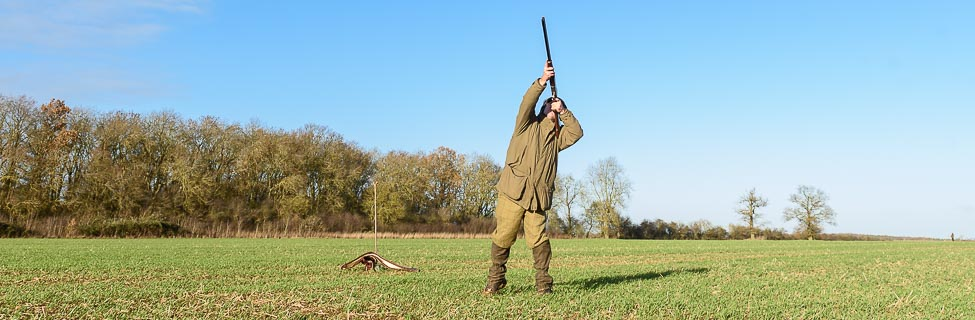 Game shooter shooting pheasant on Barnwell Shoot